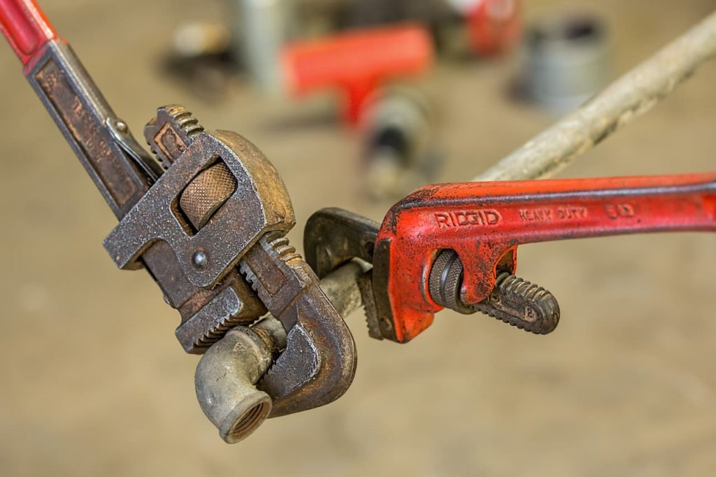 Wrenches on a pipe